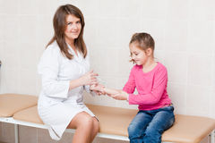Doctor examining child with stethoscope Stock Photos