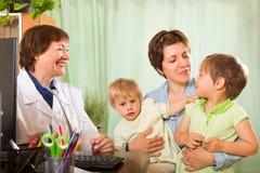 Doctor examining children Royalty Free Stock Photo