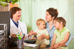 Doctor examining children Royalty Free Stock Image