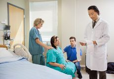 Doctor Examining CTG print Stock Images
