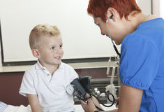 Doctor Examining cute little boy Stock Images