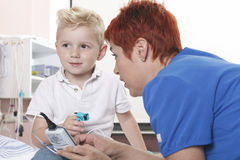 Doctor Examining cute little boy stock photography