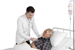 Doctor examining elderly patient Royalty Free Stock Photography