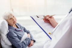 Doctor examining about general state of patient Stock Images