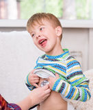 Doctor examining happy boy with stethoscope Royalty Free Stock Photo