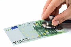 Doctor Examining Health of Euro. Man hand with phonendoscope auscultating 100 euro banknote Royalty Free Stock Photos