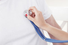 Doctor examining heartbeat. With stethoscope, close-up view Royalty Free Stock Photos
