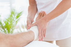 Doctor examining her patient ankle Royalty Free Stock Photography