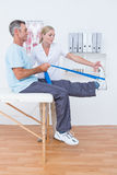 Doctor examining her patient back legs Royalty Free Stock Photography