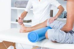 Doctor examining her patient leg Stock Photo