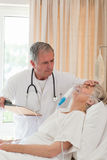Doctor examining his patient Royalty Free Stock Photo