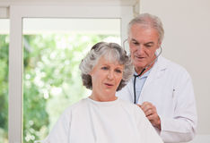 Doctor examining his patient Royalty Free Stock Image