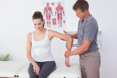 Doctor examining his patient arm Stock Images