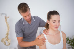 Doctor examining his patient arm Royalty Free Stock Images