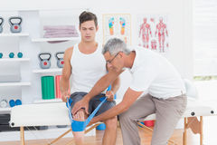 Doctor examining his patient back legs Royalty Free Stock Photo