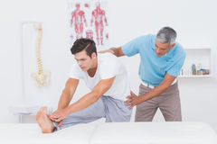 Doctor examining his patient back Royalty Free Stock Photo