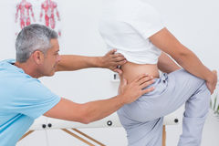 Doctor examining his patient back Stock Images