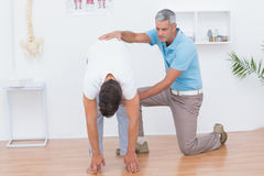 Doctor examining his patient back Royalty Free Stock Images