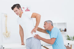 Doctor examining his patient back Royalty Free Stock Image