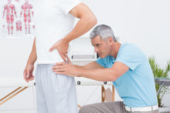 Doctor examining his patient back Stock Image