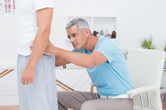 Doctor examining his patient back Stock Photography