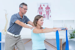 Doctor examining his patient back Royalty Free Stock Photography