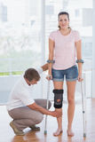 Doctor examining his patient knee Stock Images