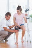 Doctor examining his patient knee Royalty Free Stock Photo