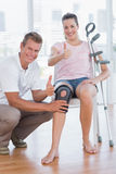 Doctor examining his patient knee Royalty Free Stock Photos