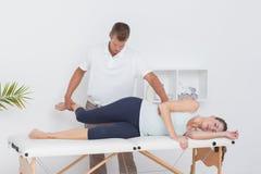 Doctor examining his patient leg Royalty Free Stock Photos