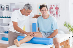 Doctor examining his patient leg Royalty Free Stock Photography