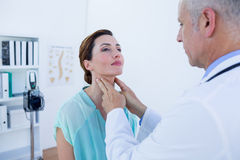 Doctor examining his patient neck Royalty Free Stock Images