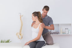 Doctor examining his patient neck Royalty Free Stock Photography