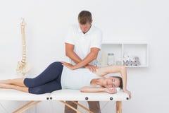 Doctor examining his patient pelvis Stock Photos