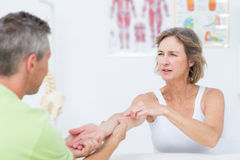 Doctor examining his patients arm Royalty Free Stock Photography