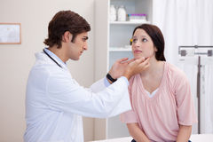 Doctor examining his patients jaw Royalty Free Stock Image