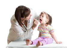 Doctor examining kid Royalty Free Stock Image