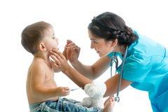 Doctor examining kid isolated on white background Stock Photography