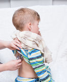 Doctor examining little boy with stethoscope royalty free stock photography