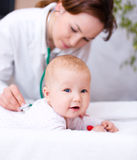 Doctor is examining little child Royalty Free Stock Images