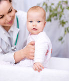 Doctor is examining little child Royalty Free Stock Image