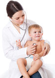 A doctor is examining a little crying patient. Isolated on a white background stock images