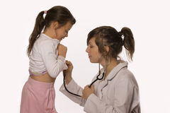 Doctor examining little girl Stock Photo