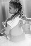 Doctor examining little girl with stethoscope, black and white poto Royalty Free Stock Images