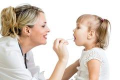 Doctor examining little kid isolated on white stock image