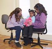 Doctor examining a little Native American girl stock photos