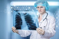 A doctor is examining a lungs image for treatment and diagnosis stock photography