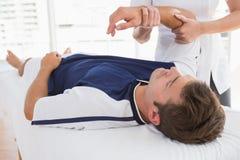Doctor examining man arm Stock Photo