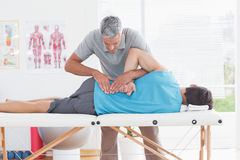Doctor examining man back Stock Image