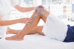 Doctor examining man leg. In medical office Royalty Free Stock Images